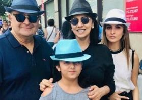 Rishi Kapoor and Neetu are all smiles as they pose with granddaughter Samara
