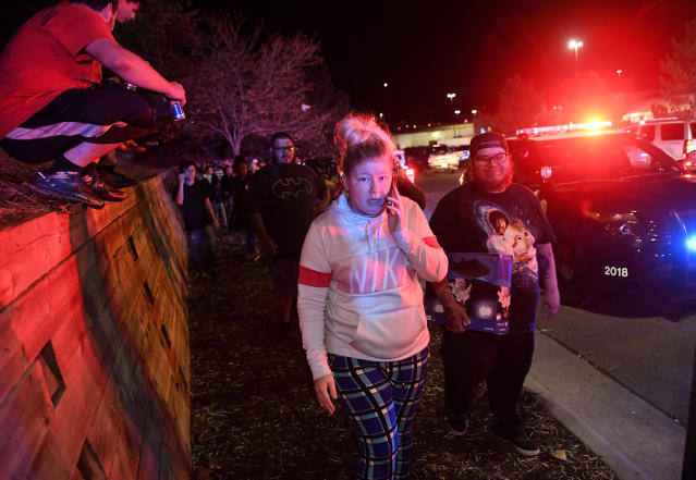 <p>Walmart employees and customers head away from the scene outside of the Walmart store where a shooting occurred inside the store at 9901 Grant Street on November 1, 2017 in Thornton, Colo. (Photo: Helen H. Richardson/The Denver Post via Getty Images) </p>
