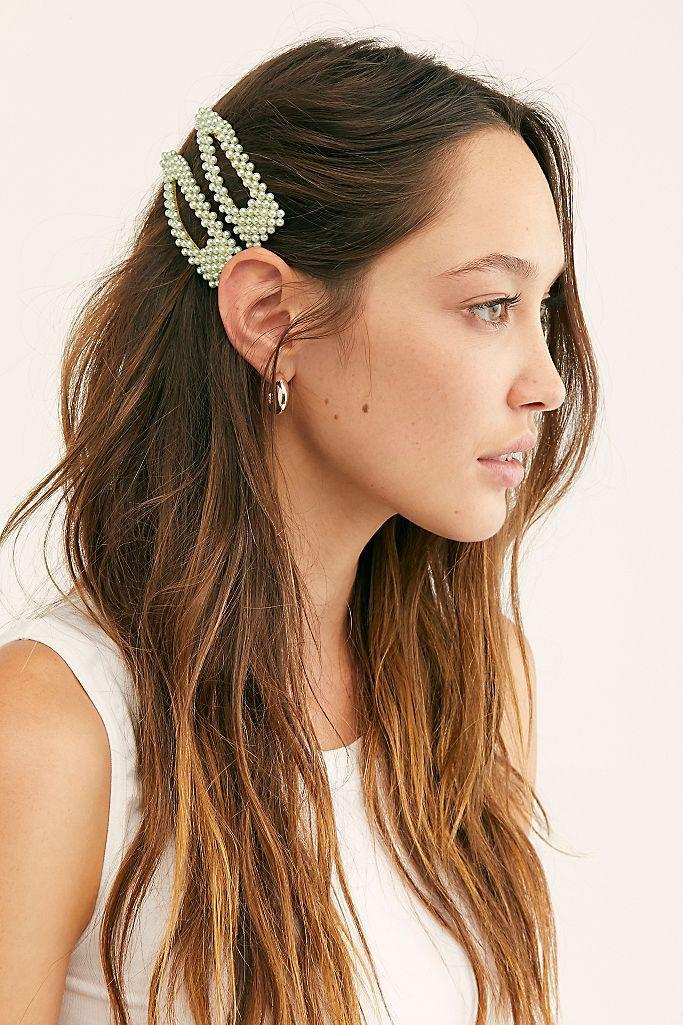 """<p>What was quite possibly the single-most-popular hair accessory of 2020, this oversized pearl snap clip has been seen <em>everywhere</em>. Models, actresses, singers, and everyday folks agree: As soon as you snap this one from Free People into your hair, you'll look effortlessly put together — even if you haven't washed your hair.</p> <p><strong>$16 for two clips</strong> (<a href=""""https://www.freepeople.com/shop/pretty-beaded-clip-set/?color=102&countryCode=US&gclid=EAIaIQobChMIxL7snJju6wIVlorICh2ZnQRbEAQYBCABEgJJ3_D_BwE&gclsrc=aw.ds&inventoryCountry=US&size=One%20Size&type=REGULAR&quantity=1"""" rel=""""nofollow noopener"""" target=""""_blank"""" data-ylk=""""slk:Shop Now"""" class=""""link rapid-noclick-resp"""">Shop Now</a>)</p>"""