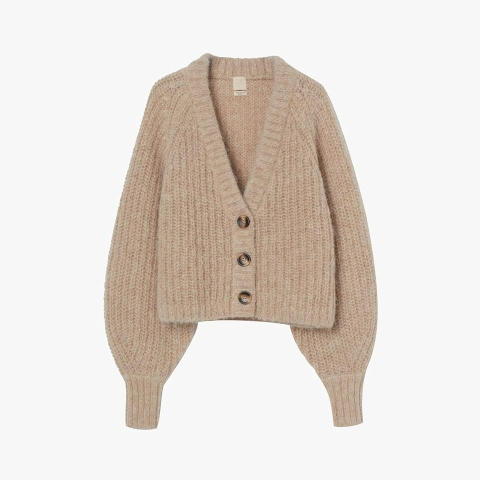 """Voluminous sleeves balance out this cropped cardigan, which is perfect for everyday wear. $60, H&M. <a href=""""https://www2.hm.com/en_us/productpage.0906097002.html"""" rel=""""nofollow noopener"""" target=""""_blank"""" data-ylk=""""slk:Get it now!"""" class=""""link rapid-noclick-resp"""">Get it now!</a>"""