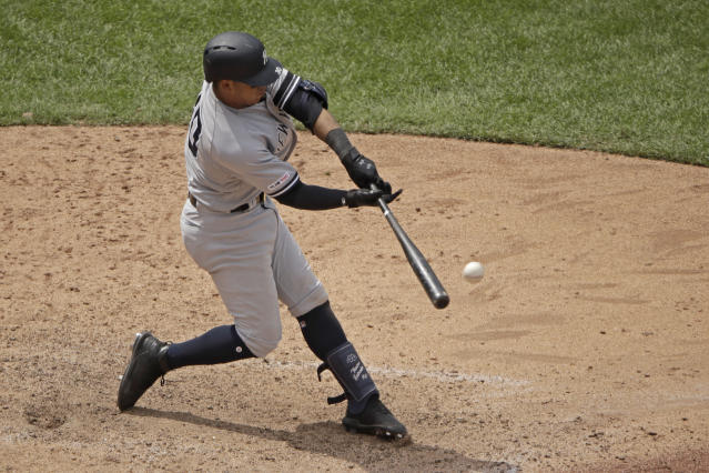 New York Yankees' Thairo Estrada hits a two-run double during the eighth inning of the first baseball game in a doubleheader against the Kansas City Royals, Saturday, May 25, 2019, in Kansas City, Mo. (AP Photo/Charlie Riedel)
