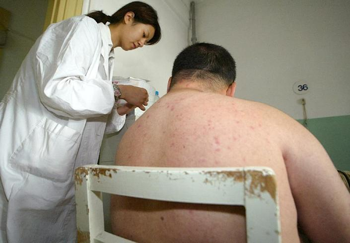The average Chinese man weighed 66.2 kilograms (146 pounds) in 2012, having put on an average 3.5 kilograms over 10 years, according to a government report (AFP Photo/Liu Jin)