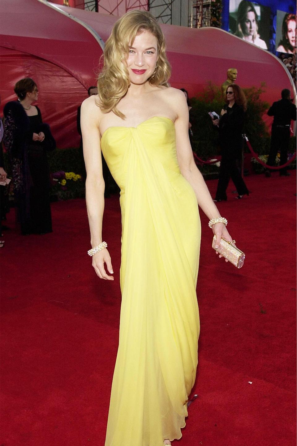 """<h2>Renée Zellweger, 2001</h2><br>A long way from donning PJs all day and micro-minis at work in her role as Bridget Jones, Renée Zellweger classed up for the red carpet in a vintage yellow frock by Jean Dresses.<br><br><em>Renée Zellweger in a vintage dress by Jean Dresses.</em><span class=""""copyright"""">Photo: Chris Weeks/Getty Images. </span>"""