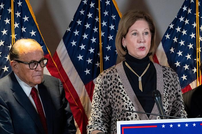In this Nov. 19, 2020 file photo, Sidney Powell, right, speaks next to former Mayor of New York Rudy Giuliani, as members of President Donald Trump's legal team, during a news conference at the Republican National Committee headquarters in Washington. On Friday, June 4, 2021, The Associated Press reported on stories circulating online incorrectly asserting election technology firm Dominion Voting Systems lost its lawsuits against Powell and Giuliani. Dominion's defamation lawsuits against the pair are ongoing, according to legal records.