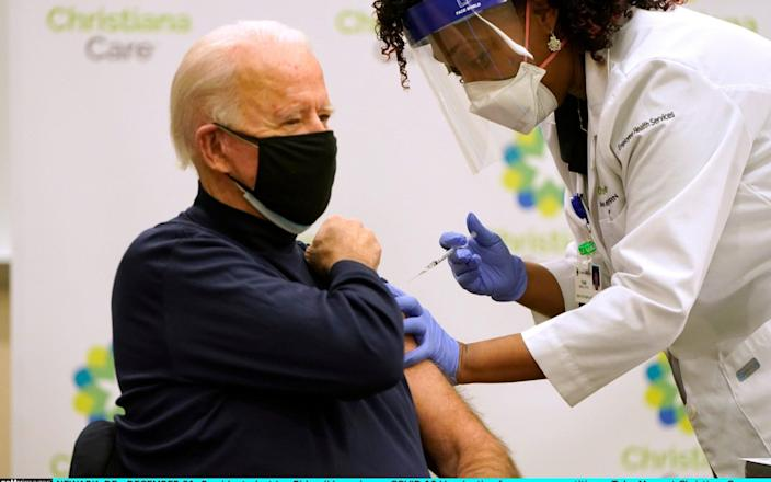 President-elect Joe Biden (L) receives a COVID-19 Vaccination from nurse practitioner Tabe Masa at ChristianaCare Christiana Hospital on December 21, 2020 in Newark, Delaware - Getty Images North America