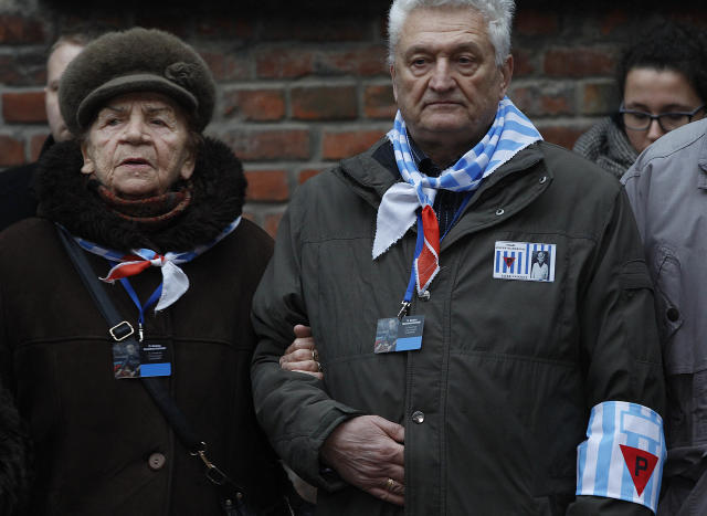 <p>Auschwitz survivors remember those killed by Nazi Germany at the execution wall of the former Auschwitz death camp on International Holocaust Remembrance Day in Oswiecim, Poland, Saturday, Jan. 27, 2018. (Photo: Czarek Sokolowski/AP) </p>