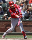 Cincinnati Reds' Jose Iglesias hits a two-run single against the San Francisco Giants during the first inning of a baseball game in San Francisco, Sunday, May 12, 2019. (AP Photo/Jeff Chiu)
