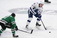 Dallas Stars center Andrew Cogliano (11) defends against a pass by Tampa Bay Lightning left wing Ondrej Palat (18) in the first period of an NHL hockey game in Dallas, Tuesday, March 2, 2021. (AP Photo/Tony Gutierrez)