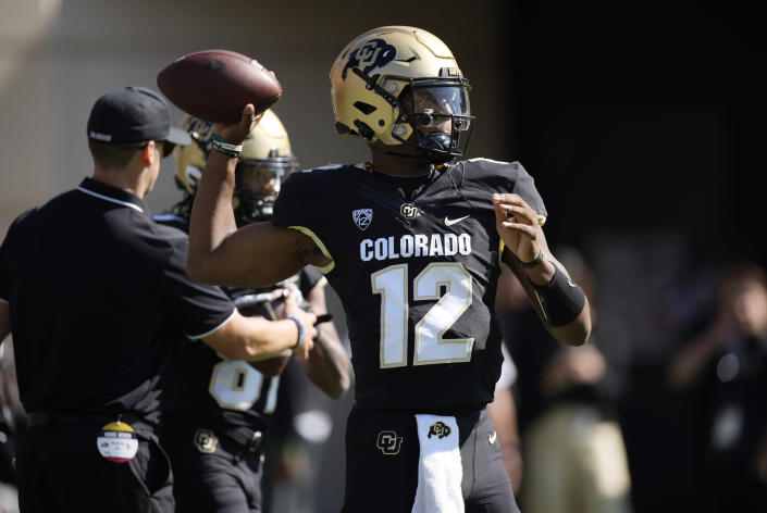 Colorado quarterback Brendon Lewis warms up before the first half of an NCAA college football game against Southern California Saturday, Oct. 2, 2021, in Boulder, Colo. (AP Photo/David Zalubowski)