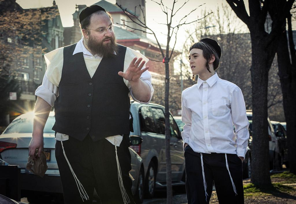 "<p>As a member of New York's ultra-strict Hasidic community, Lustig had never acted in a movie — or even seen one in a theater — before agreeing to star in this lightly fictionalized account of his own life as a widower whose son is being raised by relatives. Fortunately, his natural exuberance and good humor (which can also be glimpsed in the <a rel=""nofollow"" href=""https://www.youtube.com/watch?v=QQPPWGjnqtY"">viral videos</a> he has made over the years) makes him an ideal guide to a closed-off culture. (Photo: Sundance Institute) </p>"