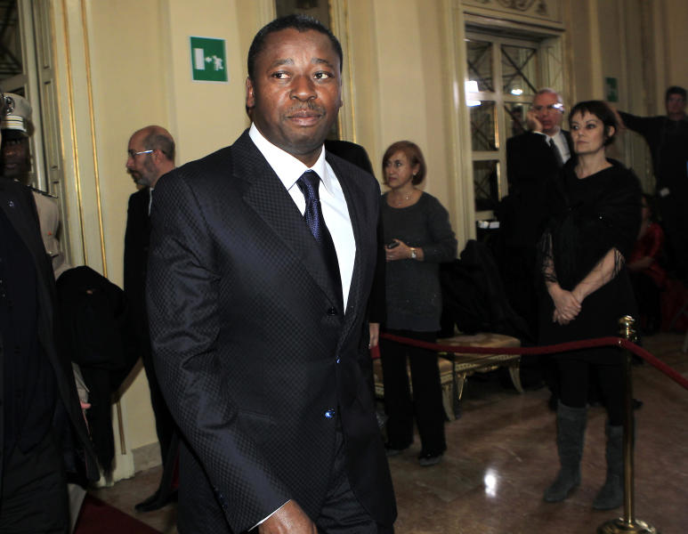 "Togo's President Faure Gnassingbe' arrives for the gala season opener at La Scala opera theater, in Milan, Italy, Saturday, Dec. 7, 2013. La Scala is concluding its bicentennial celebrations of Giuseppe Verdi's birth with Daniele Gatti conducting ""La Traviata"". Several VIPs usually attend one of the premier events of the European cultural calendar, frequented by leading industrial, political and cultural figures. (AP Photo/Antonio Calanni)"