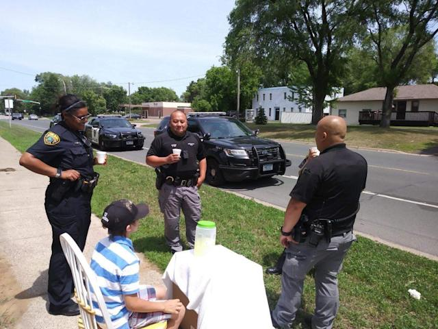 Gracen's lemonade stand was robbed, but the Brooklyn Park police showed up to help out the young businessman. (Photo: KTIS)