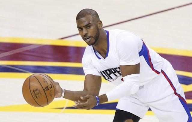 """<a class=""""link rapid-noclick-resp"""" href=""""/nba/players/3930/"""" data-ylk=""""slk:Chris Paul"""">Chris Paul</a> will spend next year in a <a class=""""link rapid-noclick-resp"""" href=""""/nba/teams/hou/"""" data-ylk=""""slk:Houston Rockets"""">Houston Rockets</a> uniform after six years with the LA Clippers. (AP)"""