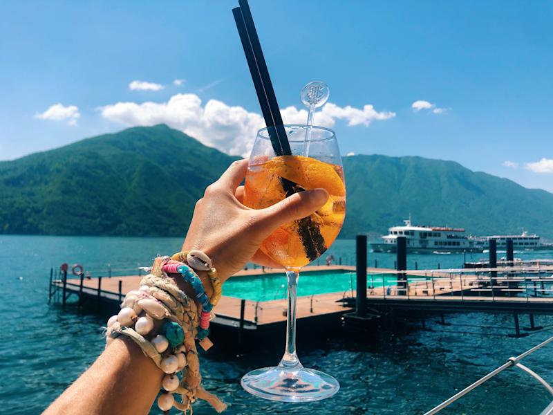 Drinking Aperol Spritz on the floating beach at Grand Hotel Tremezzo.