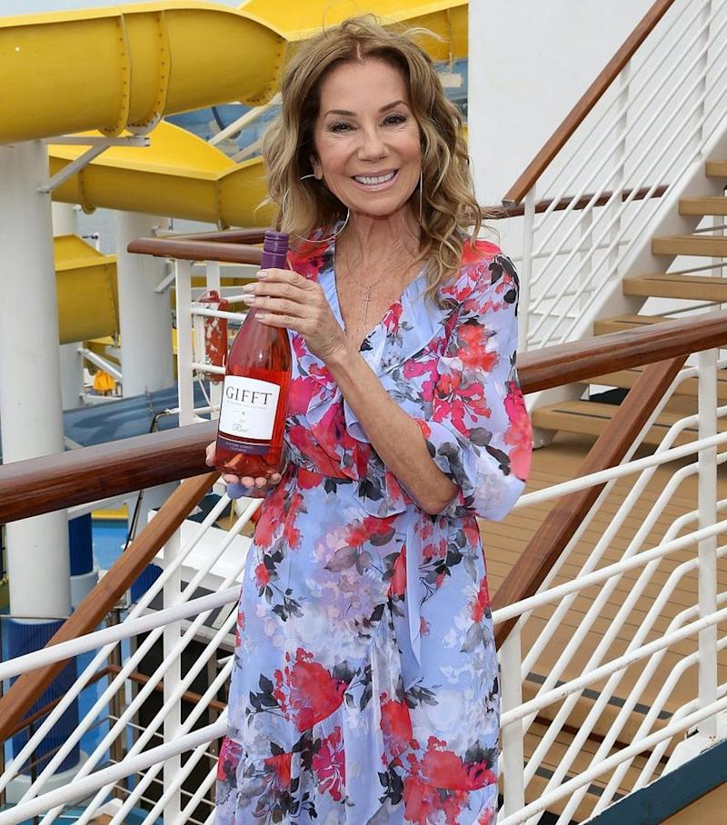 Kathie Lee Gifford with a bottle of her GIFFT wine, which Carnival serves across its fleet, aboard the Carnival Sunrise on May 23 in N.Y.C. | Gary Miller for Carnival Cruise Line