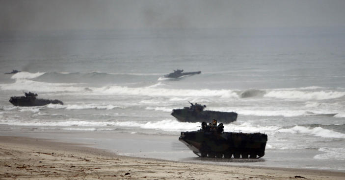 FILE - In this Friday June 2, 2010 file photo, Amphibious Assault Vehicles storm Red Beach during exercises at Camp Pendleton, Calif. Marines are training in seafaring tanks for the first time since nine men died when when one of the troop carriers sank off the Southern California coast during an exercise on July 30, 2020. The Orange County Register reports Marines from Camp Pendleton resumed exercises in water recovery and troop transfers, without troops in early April 2021. The Marine Corps has said that last year's accident was caused by inadequate training, shabby maintenance and poor judgment by commanders. (AP Photo/Lenny Ignelzi, File)