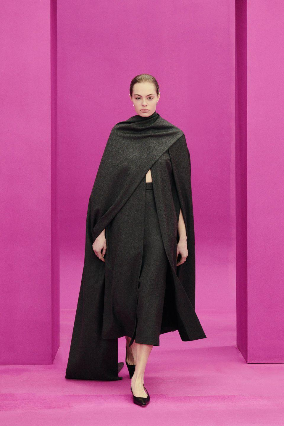 """<p>Finding out Emilia Wickstead drew inspiration from classic cinema is hardly a shock. The Brit designer has a way with the classic and ladylike. For fall 2021, the cinematography that drew her in was based on three films: <em>Teorema </em>(1968) by Pier Paolo Pasolini, <em>I Am Love </em>(2009) by Luca Guadagnino, and <em>Rear Window </em>(1954) by Alfred Hitchcock. This, ladies and gents, was not comfort dressing. Traditional suiting was done up in virgin wool gabardine and soft flanella tailored close to the body, and an off-the-shoulder dress in charcoal wool had an air of '90s minimalism. A blue and white two-piece set was giving china vibes, which makes sense given Hitchcock's brief to stylist Edith Head was that Grace Kelly """"was to look like a piece of Dresden china,"""" in <em>Rear Window</em>. This is a collection for women who are, at heart, utterly allergic to sweatpants. —<em>Kerry Pieri</em><br></p>"""