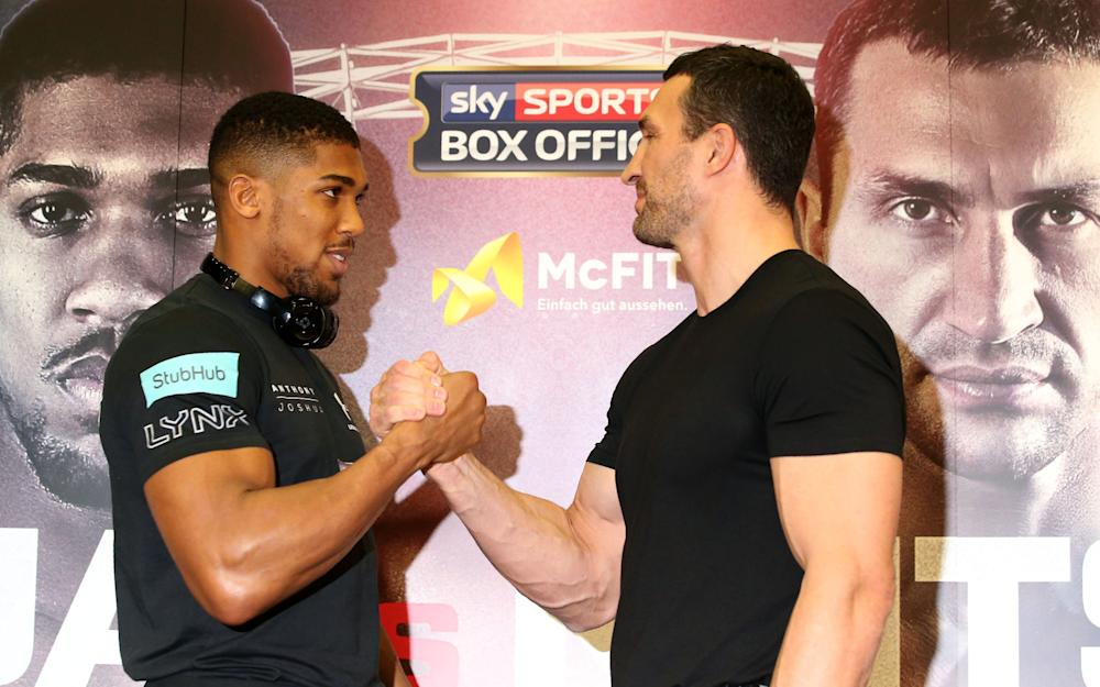 Britain's Anthony Joshua (L) poses with Ukraine's Wladimir Klitschko during a press conference at Wembley Stadium  - Credit: AFP