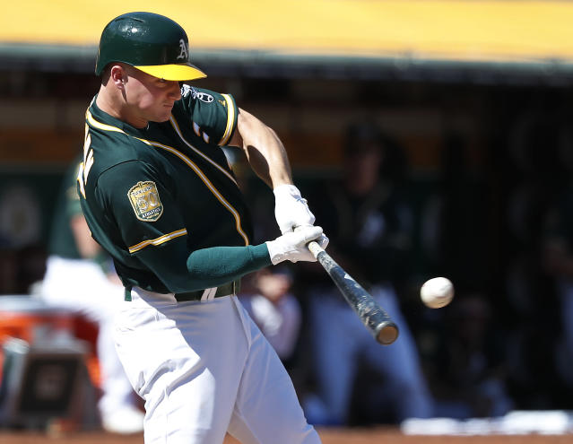 Oakland Athletics' Matt Chapman hits a double to drive in two runs against the Oakland Athletics during the third inning in a baseball game in Oakland, Calif., Thursday, Sept. 20, 2018. (AP Photo/Tony Avelar)