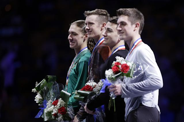 The top four men's skaters, from left, Jason Brown, second place; Jeremy Abbott, first place; Max Aaron, third place, and Joshua Farris pose on the awards stand at the medals ceremony at the U.S. Figure Skating Championships in Boston, Sunday, Jan. 12, 2014. (AP Photo/Steven Senne)