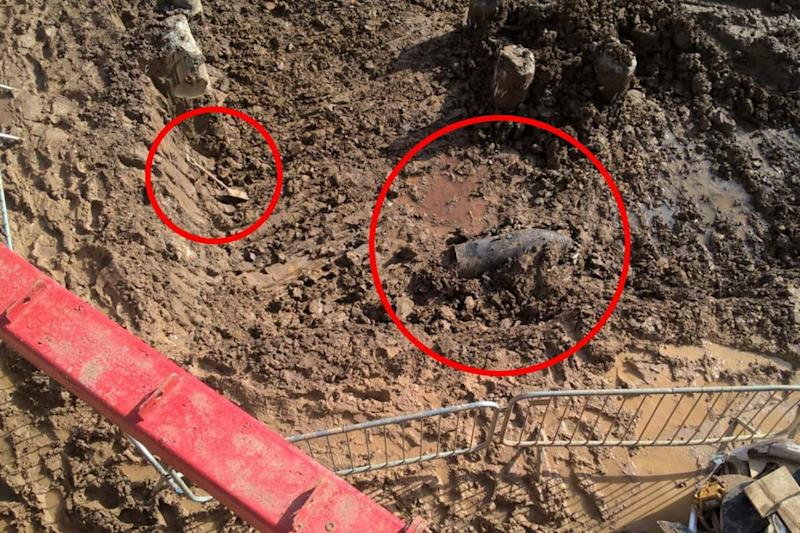 The bomb, circled right, and a spade also circled for scale (London Fire Brigade)
