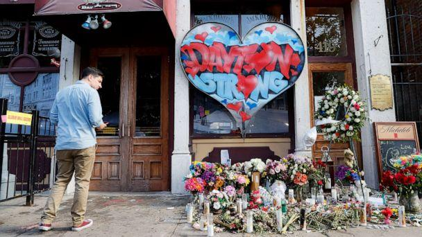 PHOTO: A pedestrian passes a makeshift memorial for the slain and injured victims of a mass shooting that occurred in the Oregon District early Sunday morning, Wednesday, Aug. 7, 2019, in Dayton, Ohio. (John Minchillo/AP)
