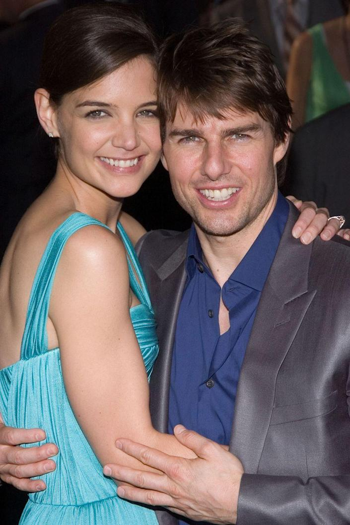 """<p>The infamous couch jumper popped the question to Katie on top of the Eiffel Tower in 2005 (très romantique!) eight weeks after they first met, according to <a class=""""link rapid-noclick-resp"""" href=""""https://www.hollywoodreporter.com/news/tom-cruise-katie-holmes-timeline-divorce-343591"""" rel=""""nofollow noopener"""" target=""""_blank"""" data-ylk=""""slk:The Hollywood Reporter""""><em>The Hollywood Reporter</em></a>. TomKat divorced in 2012.</p>"""