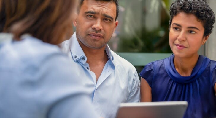 Couple discusses cost basis with their financial advisor