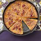 """<p>Amp up your classic cornbread recipe with crispy bacon and cheddar cheese. It's great for special occasions like Thanksgiving! </p><p><a href=""""https://www.thepioneerwoman.com/food-cooking/recipes/a34776419/bacon-cheddar-skillet-cornbread/"""" rel=""""nofollow noopener"""" target=""""_blank"""" data-ylk=""""slk:Get Ree's recipe."""" class=""""link rapid-noclick-resp""""><strong>Get Ree's recipe.</strong></a></p>"""
