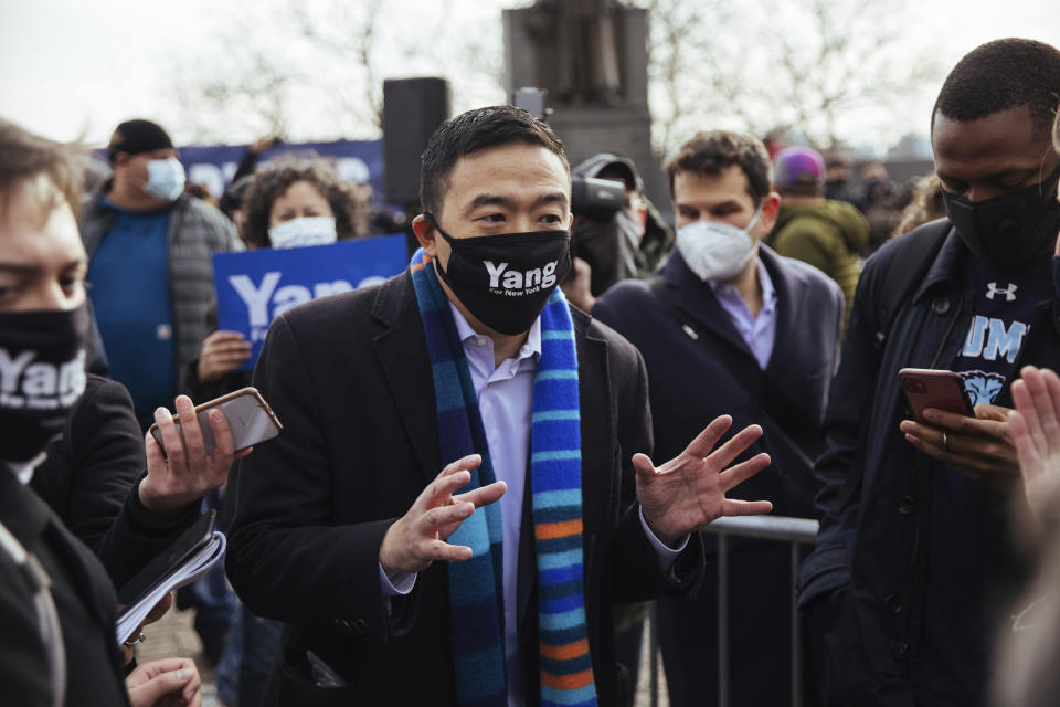 Andrew Yang takes questions from the press after he announced his run for New York City Mayor during a press conference in Morningside Park on Thursday, Jan. 14, 2021, in New York. (AP Photo/Kevin Hagen)
