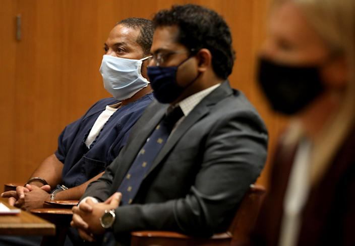 (L to R) Juwan Deering listens along with his attorney Imran Syed of the Michigan Innocence Clinic and Oakland County Prosecutor Karen McDonald in the courtroom of Judge Jeffery Matis at the Oakland County Circuit Court in Pontiac on Tuesday, September 21, 2021.