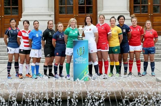 (L-R) Captains from Hong Kong, Japan, Italy, New Zealand, France, Ireland, England, Canada, Australia, US Wales and Spain pose with the trophy in Dublin ahead of the women's rugby union World Cup on August 6, 2017