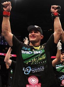 Junior dos Santos raised his arms in victory after defeating Shane Carwin in UFC 131's main event