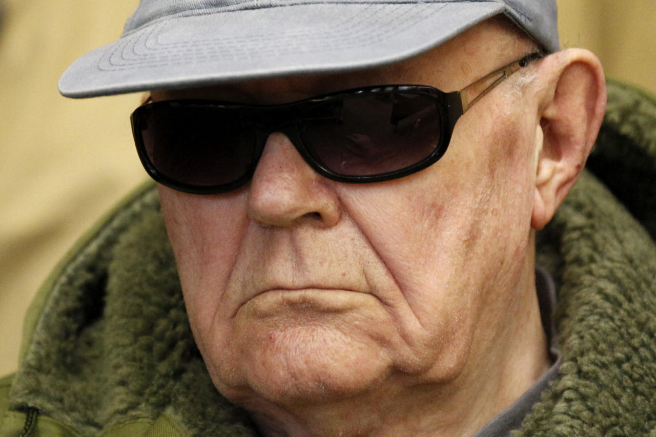 FILE - In this March 17, 2011 file picture John Demjanjuk, waits in a Munich court room. German police say John Demjanjuk, who was charged with 28,060 counts of accessory to murder and convicted last year of serving as a Nazi death camp guard, has died. Rosenheim police official Kilian Steger told The Associated Press the 91-year-old died Saturday March 17, 2012 at the home for elderly people in southern Germany where he stayed since the end of his trial in Munich last year. Demjanjuk, a retired Ohio autoworker, was deported to Germany in 2009 to face trial after being stripped of his U.S. citizenship. (AP Photo/dapd/ Sebastian Widmann,Pool,File)