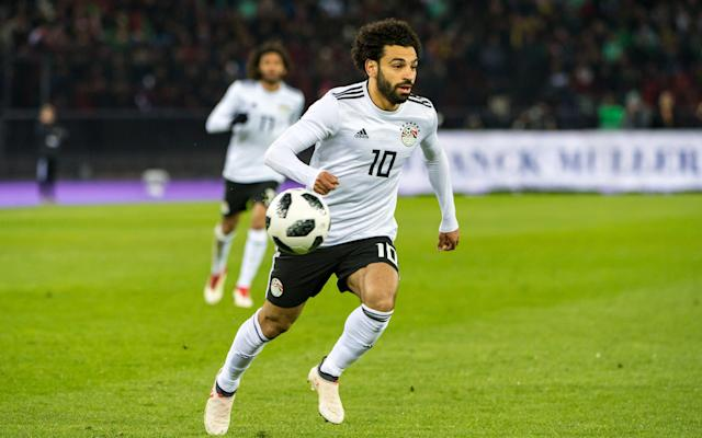 Here we take a look at Egypt's World Cup squad and the other things it will be handy to know about the Group A contenders. Egypt's World Cup squad - the 23 names Goalkeepers: Sherif Ekramy (Al Ahly), Essam El Hadary (Al Taawoun), Mohamed El Shennawy (Al Ahly) Defenders: Mohamed Abdel-Shafi (Al Fateh), Ayman Ashraf (Al Ahly), Ahmed Elmohamady (Aston Villa), Ahmed Fathi (Al Ahly), Omar Gaber (Los Angeles FC), Ali Gabr (Zamalek), Mahmoud Hamdy (Zamalek), Ahmed Hegazi (West Bromwich Albion), Saad Samir (Al Ahly) Midfielders: Mohamed Elneny (Arsenal), Abdallah El Said (Al Ahly Jeddah), Tarek Hamed (Zamalek), Mahmoud Kahraba (Al Ittihad Jeddah), Sam Morsy (Wigan Athletic), Shikabala (Al Raed), Ramadan Sobhi (Stoke City), Mahmoud Hassan (Kasimpasa), Amr Warda (Atromitos) Forwards: Marwan Mohsen (Al Ahly), Mohamed Salah (Liverpool) Egypt's World Cup 2018 fixtures Uruguay: Friday, June 15 at 1pm Russia: Tuesday, June 19 at 7pm Saudi Arabia: Monday, June 25 at 3pm Egypt's World Cup record World Cup record: Egypt The kits See where Egypt's shirts ends up in our ranking of all 64 World Cup shirts below: World Cup kits ranked What odds are Egypt to win the World Cup? 150/1. Who's the coach? Hector Cuper led Valencia to two consecutive Champions League finals Credit: Getty Images Hector Cuper, former progressive turned crabby pragmatist after losing back-to-back Champions League finals with Valencia and Serie A on the last day of the season with Inter. Who's the star? After a scare and a prayer: 'Mo Salah, Mo Salah, Mo Salah… Running down the wing… Salah-ah-ah-ah-ah-ah-ah-ah... Egyptian King!' Fans in Egypt react to Mohamed Salah's shoulder injury in the Champions League final Credit: Getty Images Best thing about them Endless patience, a steel door defence and a world-class player in Salah cutting in from the right to strike with finishes of impudent variation. Worst thing about them A classic counter-attacking side, they can be stultifying for long stretches and stymied if the opposition scores first and sits back. You may recognise… Mop-headed, uncompromising West Brom defender Ahmed Hegazi who marks opponents with all the impropriety of a barbed-wire squid. Cameramen will be picking out… Mohamed Salah running, thanking, kneeling, sliding, posing, pointing, scoring, falling. Fans' favourite chant Will quickly and wittily turn on Abdel Fattah el-Sisi's government when things go wrong. On-field prediction Victory over Saudi Arabia but pipped for second place by the hosts. Off-field prediction Many have taken out enormous loans, so expect vibrancy tinged with hysteria and an epic comedown. Full 2018 World Cup squad lists and guides | Star to watch, odds, fans' chants and more WorldCup - newsletter promo - end of article