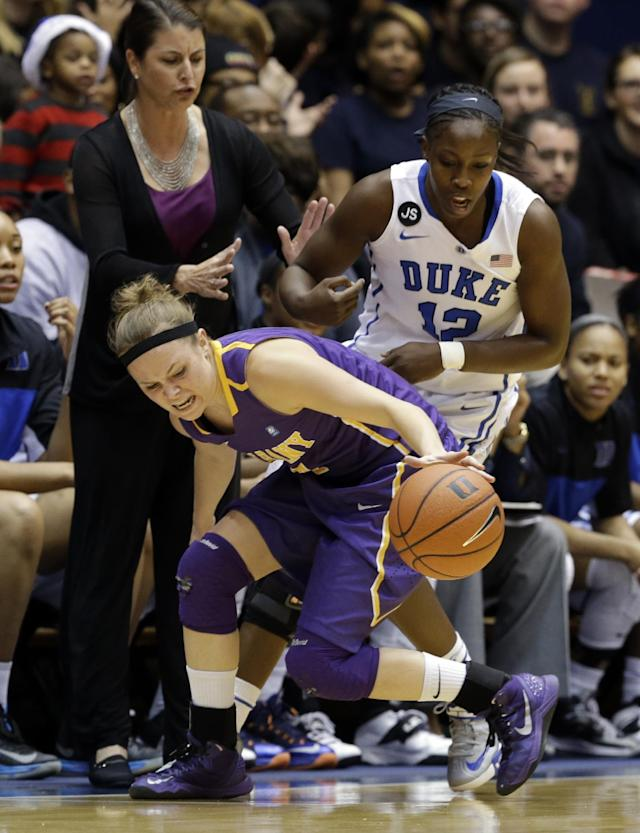 Duke's Chelsea Gray (12) and Albany's Sarah Royals chase a loose ball during the first half of an NCAA college basketball game in Durham, N.C., Thursday, Dec. 19, 2013. (AP Photo/Gerry Broome)