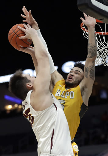 Loyola of Chicago's Cameron Krutwig, left, has his path to the basket blocked by Valparaiso's Markus Golder during the first half of an NCAA college basketball game in the quarterfinal round of the Missouri Valley Conference tournament, Friday, March 8, 2019, in St. Louis. (AP Photo/Jeff Roberson)