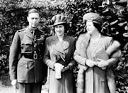 <p>Princess Elizabeth stands with her parents shortly before her 18th birthday (PA Archive) </p>