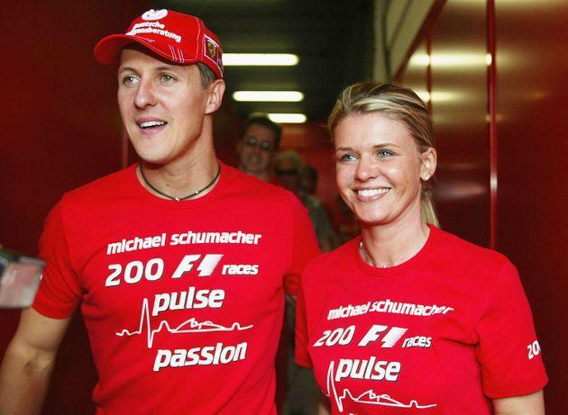 BARCELONA, SPAIN - MAY 9:  Michael Schumacher of Germany and Ferrari celebrates with his wife Corrina after competing in his 200th Grand Prix during the Spanish F1 Grand Prix on May 9, 2004, at the Circuit de Catalunya in Barcelona, Spain. (Photo by Getty Images) (Photo: Getty Images via Getty Images)