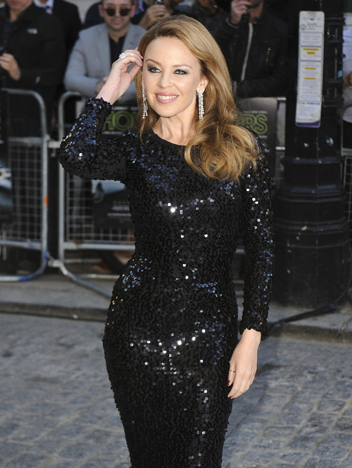 """Kylie Minogue had to postpone her """"Showgirl"""" tour when she found out in May 2005 that she had breast cancer. Cancer-free since 2006, the Australian pop star admits the disease had a huge impact on   her life. """"I learned that you never go back to a normal state, instead you have to create a new normal state. I have to accept my life for its triumphs and its other sides, take the good with the   bad,"""" said Minogue, adding, """"I experienced a world of illness and positive attitudes. These experiences contributed to making me a more mature person."""" (9/18/2012)"""