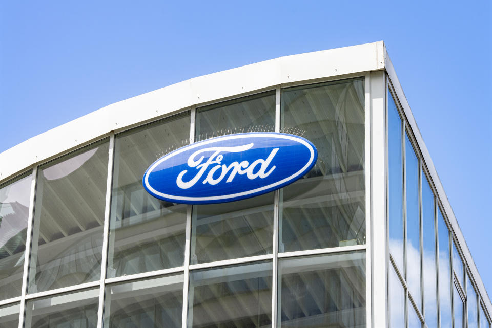 Frankfurt, Hesse/Germany - November 01, 2019: Ford logo on the glass facade of a car dealership