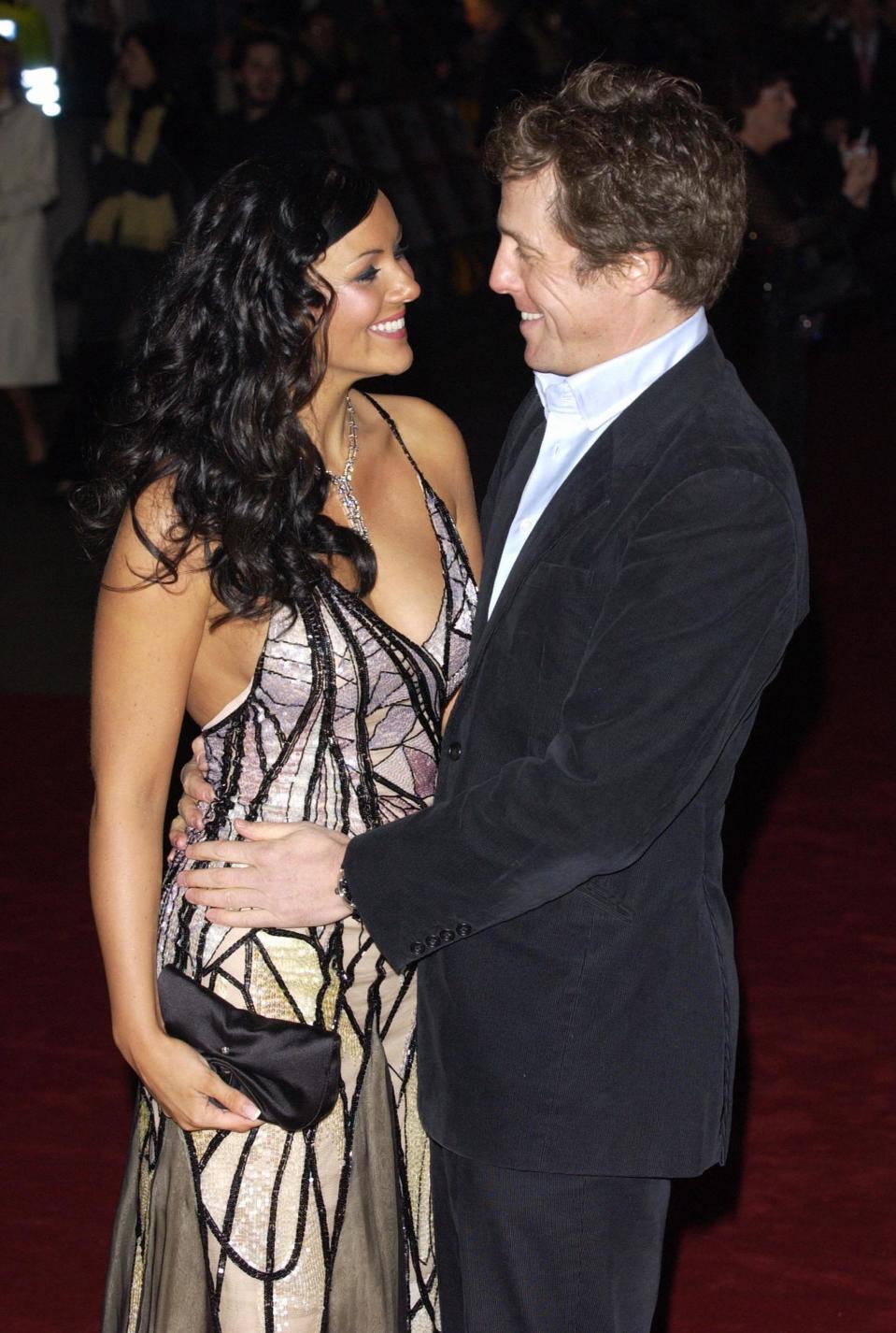 "Martine McCutcheon and Hugh Grant attend the premiere of ""Love Actually"" at the Odeon, Leicester Square. (Photo by rune hellestad/Corbis via Getty Images)"