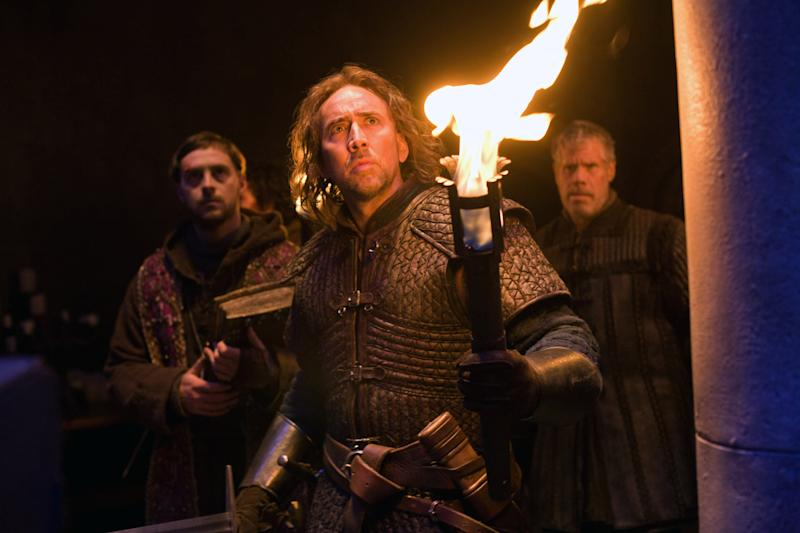 "In this film publicity image released by Relativity Media, from left, Stephen Campbell Moore, Nicolas Cage and Ron Perlman are shown in a scene from ""Season of the Witch."" (AP Photo/Relativity Media, Egon Endrenyi)"