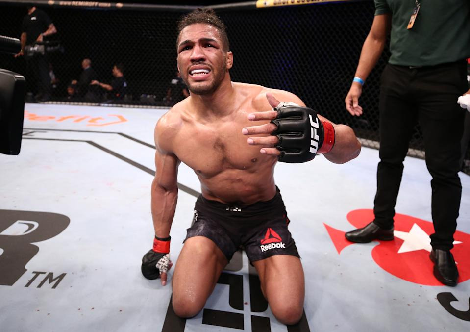 Kevin Lee reacts after his submission loss to Charles Oliveira of Brazil in their lightweight fight during the UFC Fight Night event on March 14, 2020 in Brasilia, Brazil.