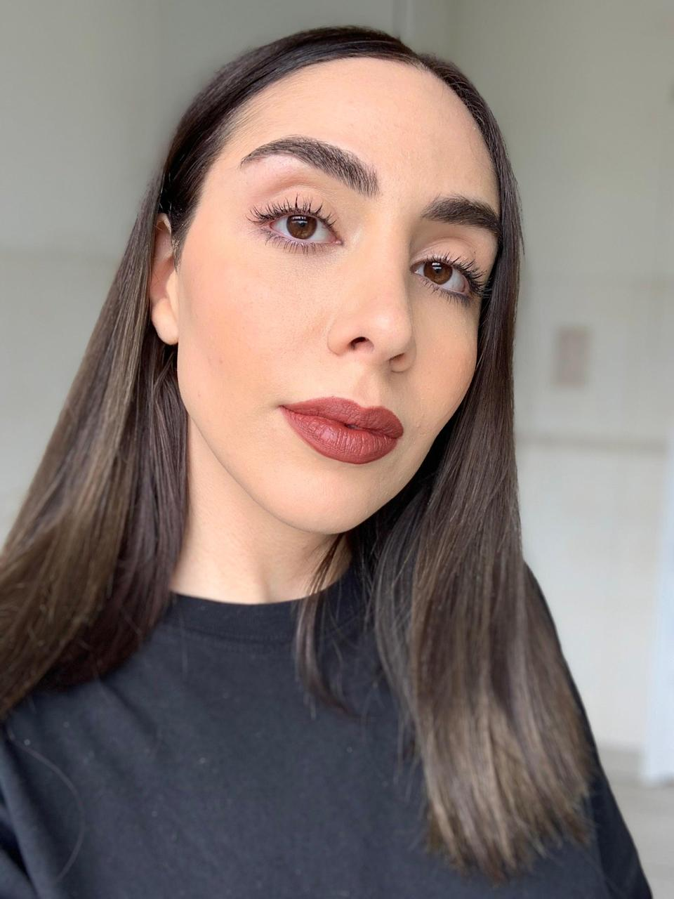 """<strong>Tester:</strong> Jacqueline<br><strong>The trend:</strong> Rusty red lips (inspired by Gwen Stefani and Courtney Cox)<br><br>""""As a self-identified <a href=""""https://www.refinery29.com/en-gb/modern-emo-makeup-looks"""" rel=""""nofollow noopener"""" target=""""_blank"""" data-ylk=""""slk:emo"""" class=""""link rapid-noclick-resp"""">emo</a>, I'm not one to shy away from dark and brooding lip colours like this one. Though '90s lipstick trends span a wealth of shades, from ultra light nude (like Vanese below) to chestnut brown (similar to Simran later on), in my mind the decade is characterised by russety, mauve hues. Influenced by Gwen Stefani, I teamed this burnt red shade with matte skin, a tiny bit of bronzer to contour my cheekbones and lashings of mascara. I also lined my lips with <a href=""""https://www.cultbeauty.co.uk/vieve-modern-lip-definer.html?variant_id=30359"""" rel=""""nofollow noopener"""" target=""""_blank"""" data-ylk=""""slk:VIEVE Modern Lip Definer in Tailored, £15"""" class=""""link rapid-noclick-resp"""">VIEVE Modern Lip Definer in Tailored, £15</a>. I adore it. It's such a throwback colour combination but it works just as well in 2021. The texture of both the lipstick and lip liner is creamy and the finish is semi-matte, so it moisturises lips. They also pass the face mask test.""""<br><br><strong>diego dalla palma</strong> Rookwood Red Lip Kit, $, available at <a href=""""https://www.lookfantastic.com/diego-dalla-palma-rookwood-red-lip-kit/13157999.html"""" rel=""""nofollow noopener"""" target=""""_blank"""" data-ylk=""""slk:LookFantastic"""" class=""""link rapid-noclick-resp"""">LookFantastic</a><br><br><strong>VIEVE</strong> Modern Lip Definer in Tailored, $, available at <a href=""""https://www.cultbeauty.co.uk/vieve-modern-lip-definer.html?variant_id=30359"""" rel=""""nofollow noopener"""" target=""""_blank"""" data-ylk=""""slk:Cult Beauty"""" class=""""link rapid-noclick-resp"""">Cult Beauty</a>"""