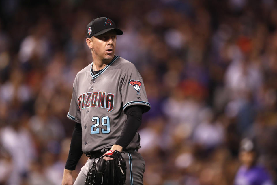 Arizona Diamondbacks relief pitcher Brad Ziegler heads to the dugout after retiring Colorado Rockies' DJ LeMahieu on a ground out with the bases loaded in the seventh inning of a baseball game Tuesday, Sept. 11, 2018, in Denver. (AP Photo/David Zalubowski)