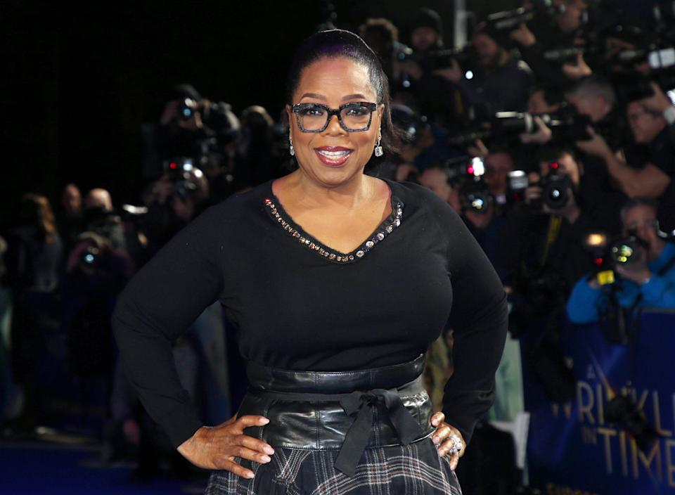 """FILE - In this March 13, 2018, file photo, actress Oprah Winfrey poses for photographers upon arrival at the premiere of the film """"A Wrinkle In Time"""" in London. Winfrey announced Wednesday, May 20, 2020 that her Oprah Winfrey Charitable Foundation will donate money to organizations dedicated to helping undeserved communities in Chicago; Nashville, Tennessee; Milwaukee, Wisconsin; and Kosciusko, Mississippi, where she was born. (Photo by Joel C Ryan/Invision/AP, File)"""