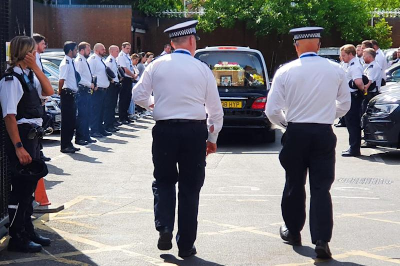 More than 100 Met officers lined the street to pay tribute