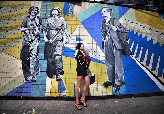 <p>A drag queen stands against a mural as she waits for the start of the Belfast Gay Pride march on August 5, 2017 in Belfast, Northern Ireland. (Photo: Charles McQuillan/Getty Images) </p>