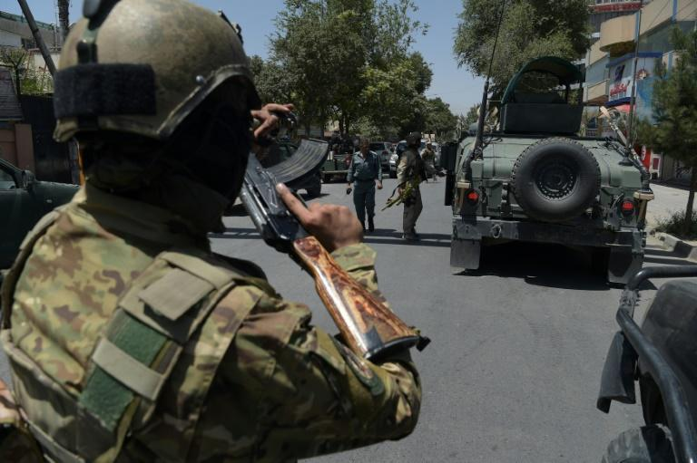 Afghan security arrive at the site of a suicide blast last month: intelligence officials say they have found a huge cache of explosives in Kabul
